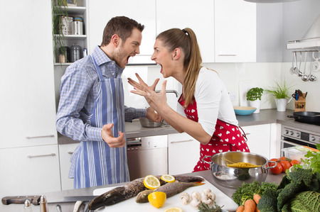arguments: Young couple crying and screaming at home: trouble under a married couple.