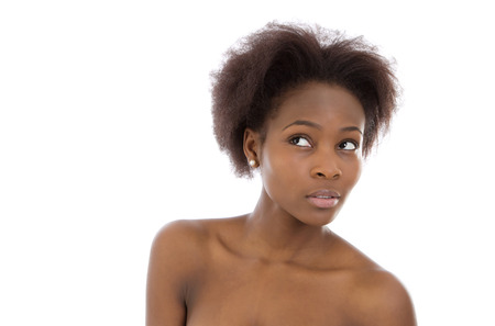 likable: Isolated beautiful and amazed young afro american woman face over white background.