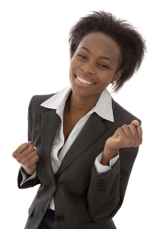 american content: Successful and happy isolated afro american black woman in business outfit. Stock Photo