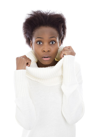 Isolated scared and shocked african american black woman in white sweater. photo