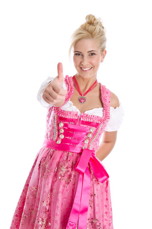 dirndl: Happy young blond woman in dirndl dress in bavarian folkart - isolated over white. Stock Photo