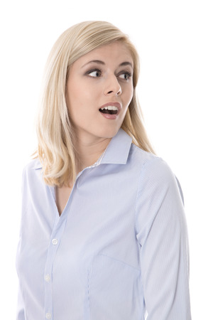 Shocked isolated young business woman looking surprised sideways to text. photo