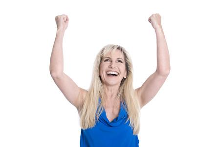 Hermosa mujer de mediana edad feliz aislado en azul con las manos en alto. Foto de archivo - 29522928