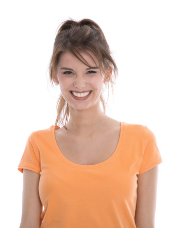 likable: Portrait of a young smiling beautiful isolated girl in orange shirt. Stock Photo