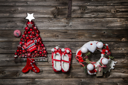 Christmas decoration country style: red, white things on wooden background. photo