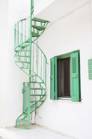 country house style: Old green stairs outdoor on a house in country style seen on the cyclades.