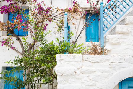 Architecture on the Cyclades. Greek Island buildings with her typical blue doors and white houses. Stock Photo