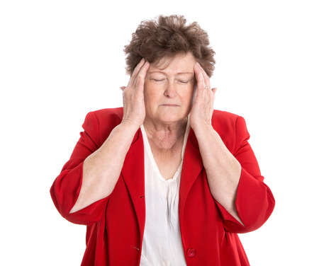 forgetfulness: Isolated older woman with headache, migraine or forgetfulness over white background