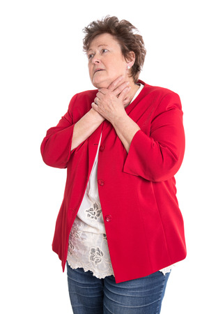 suffered: Portrait of an isolated older woman in red has sore throat