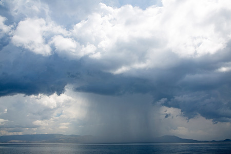 squall: Hurricane: stormy and rainy day on the sea for a horror background. Stock Photo