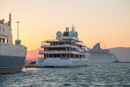 super yacht: Luxury large super or mega motor yacht in the evening on sunset. Stock Photo