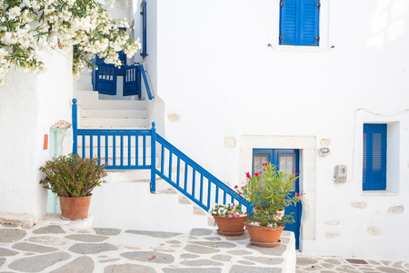 Architecture on the Cyclades. Greek Island buildings with her typical blue doors and white houses in summertime. photo