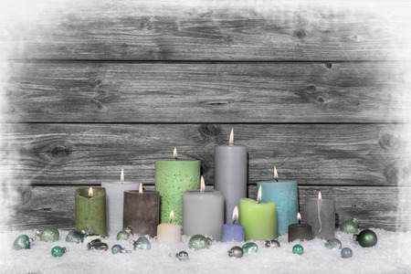 congratulatory: Christmas congratulatory card with many colored candles on wooden grey shabby chic background.