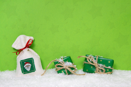 Christmas presents on snowy background. Idea for a xmas voucher. photo