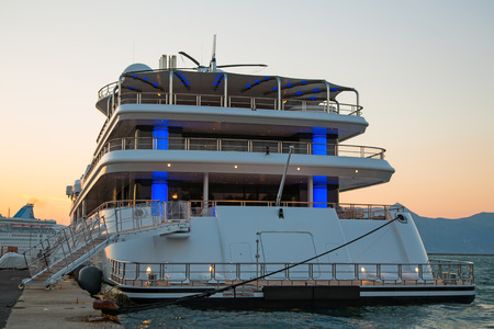 Luxury large super or mega motor yacht in the evening on sunset. Banco de Imagens