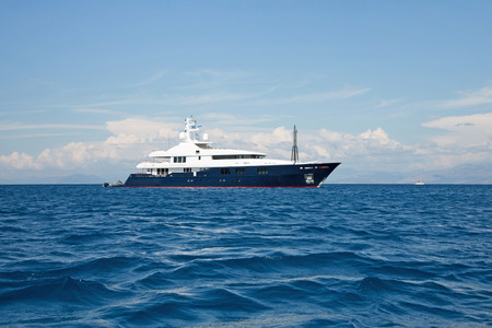 super yacht: Luxury large super or mega motor yacht in the blue ocean.