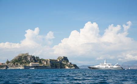 super yacht: Landscape: Luxury large super or mega motor yacht on anchor in corfu - greece. Stock Photo