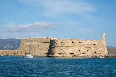 koule: Greek island crete in the cyclades  sightseeing on the old port with fort and boats on blue sky  Stock Photo