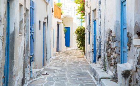 kyklades: Architecture on the Cyclades. Greek Island buildings with her typical blue doors and white houses in summertime. Stock Photo