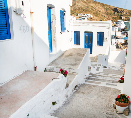 mykonos: Architecture on the Cyclades. Greek Island buildings with her typical blue doors and white houses in summertime. Stock Photo