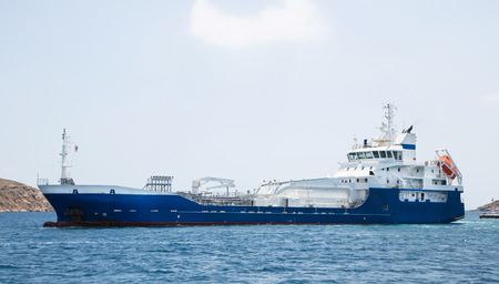 seafaring: Gas working ship on the ocean. Cargo transport on the water. Seafaring item.