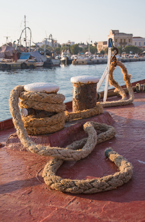 jute: In the port  Old sisal rope of an ancient ship fixed on the docks in the harbor