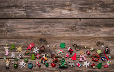Wooden xmas or christmas background with colorful decoration of miniatures. photo