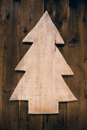 whittle: Wooden carved christmas tree for a xmas background. Idea for tinker. Stock Photo