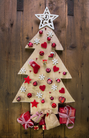 whittle: Decoration: handmade carved christmas tree with red and white miniatures.