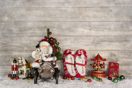 witty: Wooden witty vintage christmas background with santa and old toys for children in country style. Stock Photo