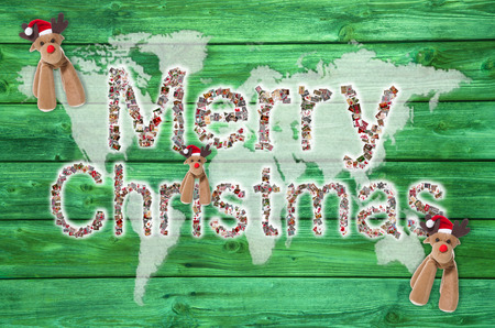 Merry christmas text for around the world with map or globe in green, red and white colors  Font is of different xmas images  photo