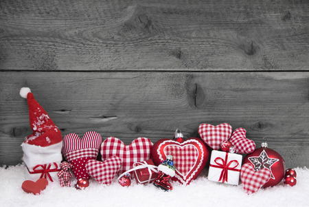 red and white: Red white checked christmas decoration on grey wooden shabby background  Stock Photo