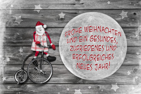 German christmas greeting card in red, white and grey color with text merry xmas and a successful happy new year  photo