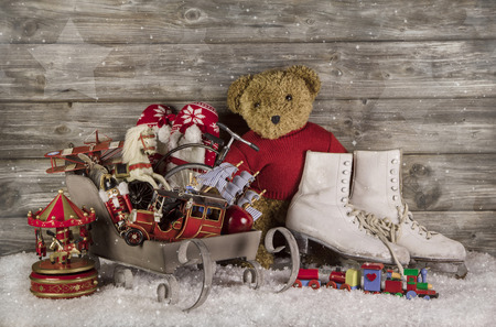 Old children toys on wooden background for christmas decoration in vintage style  photo