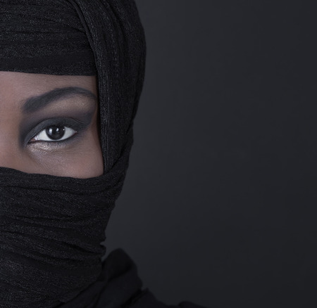 Beautiful black oriental colored woman face: eyes and beauty. photo