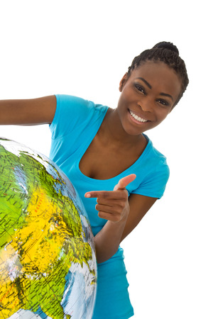 globetrotter: Isolated colored young woman holding a globe in her hands wearing a turquoise shirt.