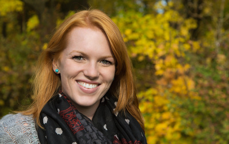 red haired: Portrait, Natural red-haired young smiling woman in autumn on a walk. Stock Photo