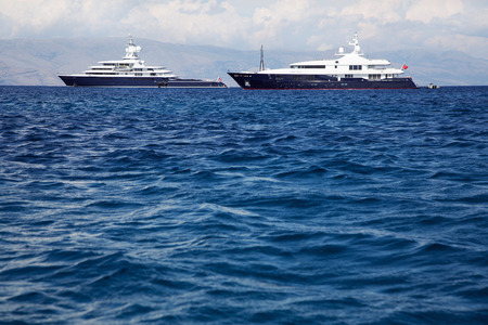 motor boats: Gigantic big and large luxury yacht with sail boat and helicopter landing place on bord. Investment concept for millionaires.