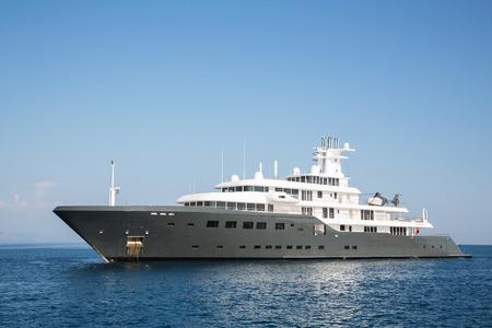 Gigantic big and large luxury mega or super motor yacht. Investment for millionaires or billionaires.