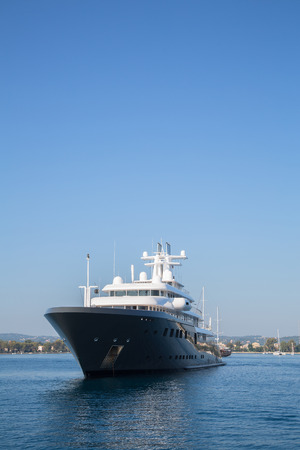 super yacht: Gigantic big and large luxury mega or super motor yacht. Investment for millionaires or billionaires.
