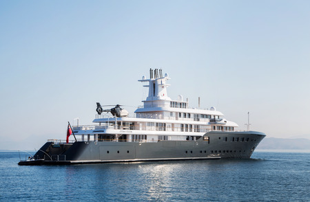 Gigantic big and large luxury mega or super motor yacht. Investment for millionaires or billionaires.