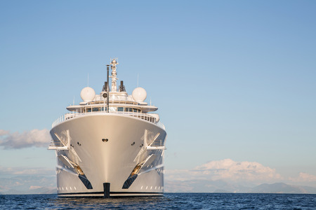 Gigantic big and large luxury mega or super motor yacht on the blue ocean.