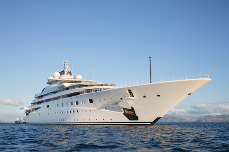 Gigantic big and large luxury mega or super motor yacht on the blue ocean.