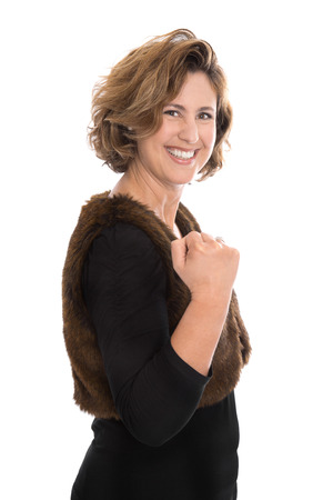 Isolated middle aged woman in 40s making fist - happy about her success.