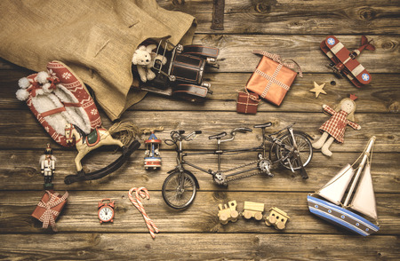 Vintage christmas decoration: old nostalgic children toys on wooden rustic background. photo