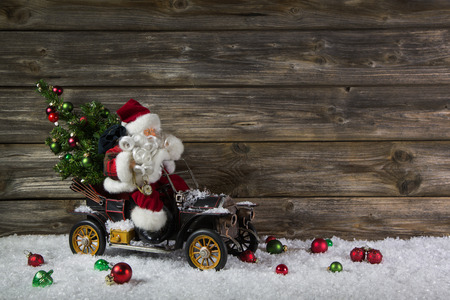 Funny wooden christmas background with santa claus for a voucher or coupon. Stock Photo