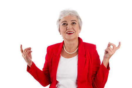 Happy isolated older woman in red cheerful and happy about her success. Also a concept for senior manager or employees. photo