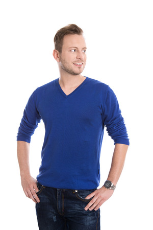 sideways glance: Isolated young attractive blond man in blue pullover looking sideways to text.