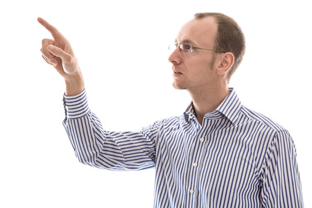 humorously: Isolated serious man in blue shirt pointing with his finger sideways on text. Stock Photo