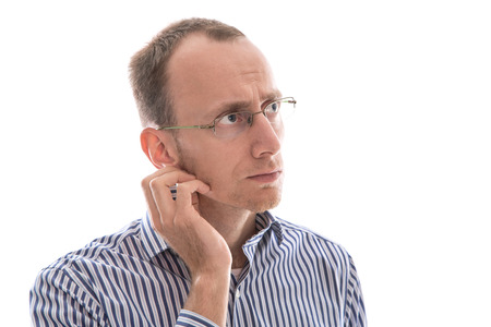 Serious and absent-minded isolated businessman with glasses and bald looking sideways. photo